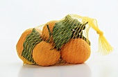 Net Bag of Satsuma Tangerines on a White Background