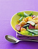 Colorful Bowl of Roasted Vegetables with Arugula