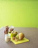 Still Life with Quinoa, a Pear, Cinnamon Sticks and Walnuts