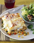 A Piece of Vegetable Lasagna with Salad