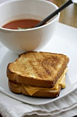 A Grilled Cheese Sandwich with a Bowl of Tomato Soup