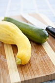 Organic Yellow Squash and Zucchini on a Cutting Board, Knife