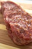 Seasoned Raw Top Sirloin Steak on a Cutting Board
