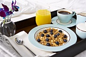 Breakfast in Bed Tray with Cereal with Blueberries, Coffee and Juice