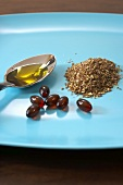 Flax Seeds, Flax Seed Oil and Flax Seed Capsules on a Plate