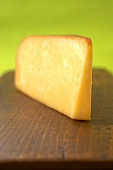 A Wedge of Smoked Gouda on a Wooden Board