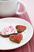 Three Frosted, Chocolate Heart Shaped Cookies