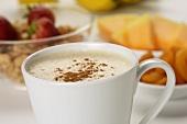 Mug of Coffee Latte on Breakfast Table