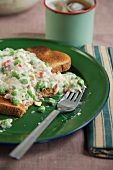 Partially Eaten Creamed Tuna on Toast on a Plate with a Fork
