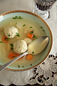 Bowl of Matzoh Ball Soup with Spoon, Wine