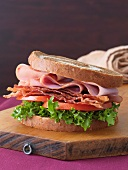 BLT with Ham on Marble Bread on Cutting Board