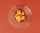 Orange Cheddar Cheese Cubes in a Bowl, From Above