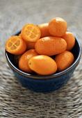 Bowl of Fresh Whole Kumquats, One Halved