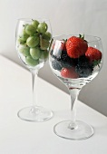 Two Wine Glasses Filled with Assorted Berries