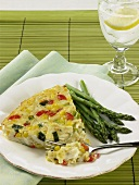 Piece of Vegetable Quiche; Fork with Piece of Quiche