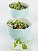 Two Bowls of Pea and Potato Salad