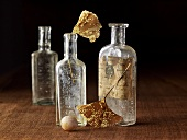 Dried gingko leaves in old pharmacy bottles