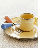 Metal cup, plate, fork and spoon (children's tableware)