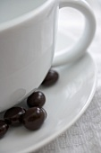 Chocolate Covered Espresso Beans on Saucer with Mug
