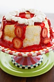 Strawberry Angel Food Cake with Whipped Cream on a Cake Plate