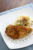 Baked Chicken Cordon Bleu with Garlic Mashed Potatoes on a Plate