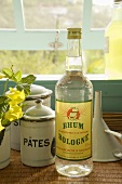 Bottle of Rum on a Counter by an Opened Window