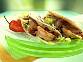 Shrimp Tacos on a Stack of Green Plates