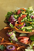 Colorful Salad in a Wooden Bowl Surrounded by Ingredients