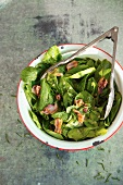Spinach Salad with Warm Bacon Dressing in a Serving Bowl
