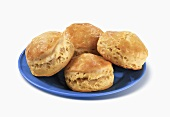 Four Biscuits on a Blue Plate, White Background