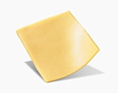 A Slice of Yellow American Cheese on a White Background