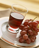 Red Wine with Red Grapes