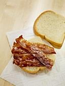 Crispy Strips of Bacon on White Bread