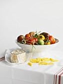 Italian Ingredients Still Life; Tomatoes, Pasta and Goat Cheese