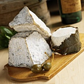 Three Types of Aged French Goat Cheese (LeGrand Carpin, Valencay Jaquin Ashed Pyramid & Chabis Perigord)