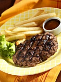Grilled Chopped Steak with BBQ Sauce and French Fries