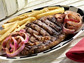 Boneless Rib Steak with Red Onions and French Fries
