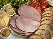 Sliced Ham with Bread Slices, Condiments, Vegetables and Cheese