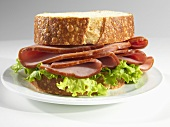 A Ham Sandwich with Lettuce on Thick Cut Sourdough Bread
