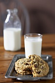 Chocolate Chip Cookies and a Glass of Milk on a Dish, Bottle of Milk