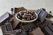 Bowl of Chocolate Covered Espresso Beans Surrounded by Ingredients