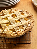 Peach Almond Pie with a Lattice Top on a Cooling Rack