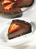 Slice of Dark Chocolate Velvet Pie with Sliced Strawberries