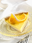 Slice of Orange Custard Tart with Orange Twist and Powdered Sugar