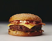 Cheeseburger with Bacon, Mayonnaise and Onions on a Sesame Seed Bun