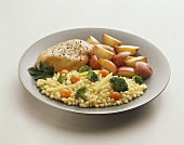 Chicken Breast with Mixed Vegetables and Potatoes on a Plate