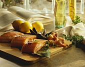 Assorted Raw Seafood on a Cutting Board on a Kitchen Counter, Salmon, Shrimp, Mussels