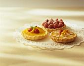 Three Assorted Tartlets on a Paper Doily