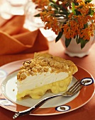 Slice of Banana Cream Pie on a Plate with a Fork