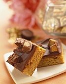Two Reeses Peanut Butter Cup Blondie Bars on a White Plate